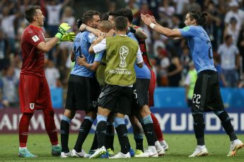 PN. Sochi (Russian Federation), 30/06/2018.- Players of Uruguay celebrate at the end of the FIFA World Cup 2018 round of 16 soccer match between Uruguay and Portugal at the Fisht Stadium, in Sochi, Russia, 30 June 2018. (RESTRICTIONS APPLY: Editorial Use Only, not used in association with any commercial entity - Images must not be used in any form of alert service or push service of any kind including via mobile alert services, downloads to mobile devices or MMS messaging - Images must appear as still images and must not emulate match action video footage - No alteration is made to, and no text or image is superimposed over, any published image which: (a) intentionally obscures or removes a sponsor identification image; or (b) adds or overlays the commercial identification of any third party which is not officially associated with the FIFA World Cup) (Mundial de Fútbol, Rusia) EFE/EPA/PAULO NOVAIS EDITORIAL USE ONLY EPA-EFE/PAULO NOVAIS EDITORIAL USE ONLY EDITORIAL USE ONLY
